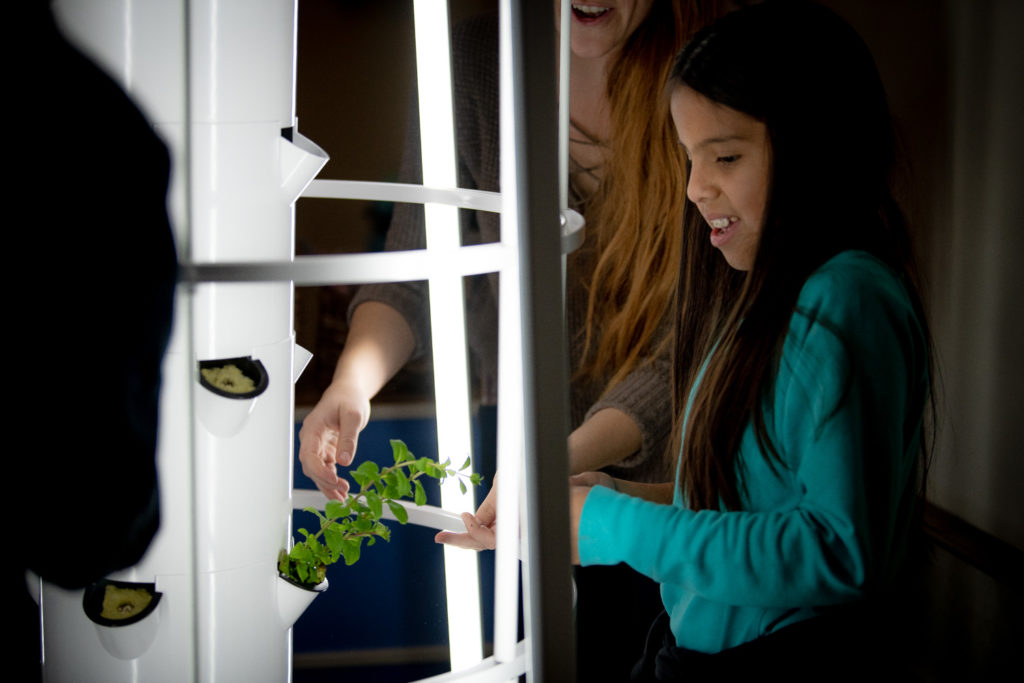 girl with indoor farming